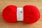 Le Mini Ourson Rouge